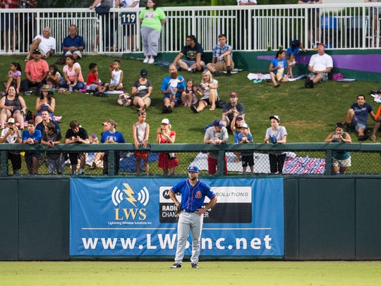 St. Lucie Mets player Tim Tebow waits in the outfield