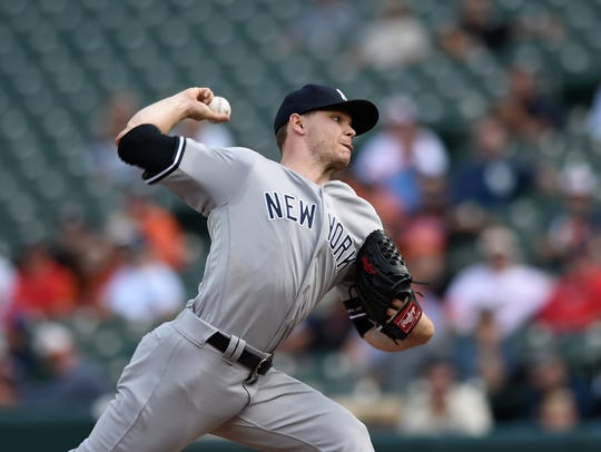 New York Yankees pitcher Sonny Gray throws against