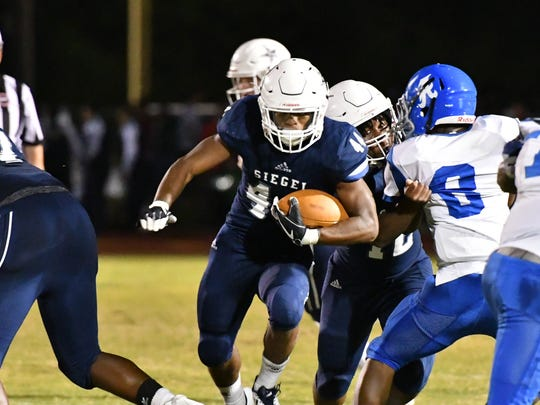 "Siegel senior running back Lelan Wilhoite (44) is ""day to day"" after suffering a leg injury in last week's win over Warren County."