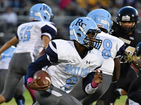 Rocky Fork Middle QB Charles Ingram looks for running room during Saturday's Rutherford County Middle School football championship game. Christiana won 44-8.