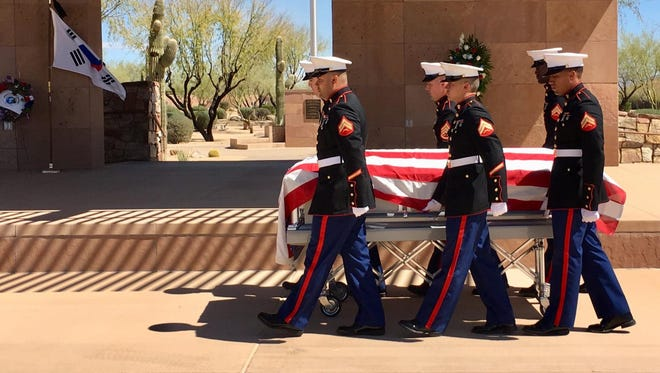 Marines carry the flag-draped casket of Sgt. Johnson McAfee Jr. 68 years after he was killed in action.