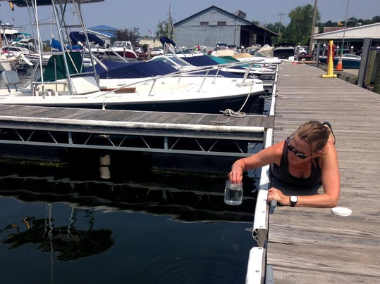 2015-07-12-Fisher-Lori-Perkins Pier-1 A Water Conditions-Taking a Sample