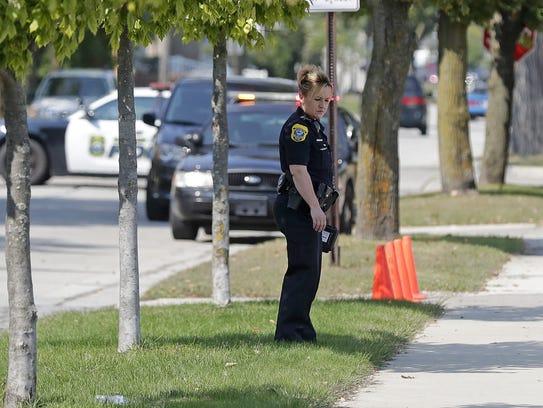 Green Bay Police Department investigators search the
