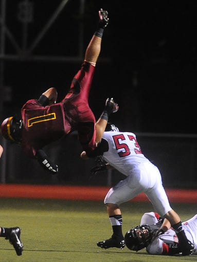 Roosevelt's Chase Vinatieri flips over the back of Brandon Valley's  Lucas Chmela on Friday, August 29, 2014 at Howard Wood Field.