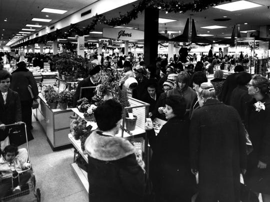 12/19/1966: Shoppers in Alexander's department store in Paramus.