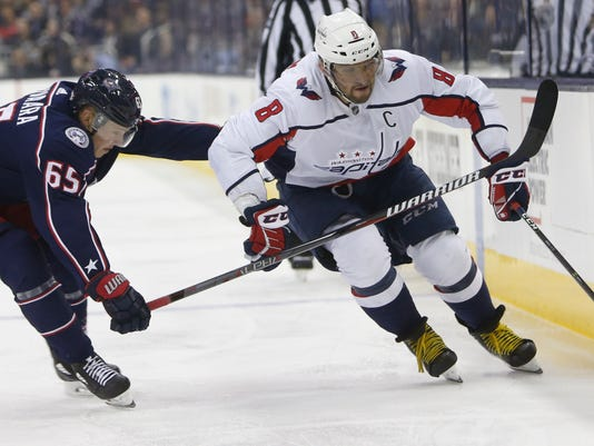 Washington Capitals' Alex Ovechkin, right, of Russia, carries the puck as Columbus Blue Jackets' Markus Nutivaara, of Finland, defends during the third period of an NHL hockey game Tuesday, Feb. 6, 2018, in Columbus, Ohio. The Capitals won 3-2. (AP Photo/Jay LaPrete)