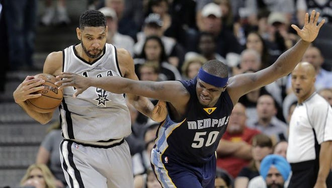 San Antonio Spurs center Tim Duncan (21) steals the ball from Memphis Grizzlies forward Zach Randolph (50) during the second half in Game 1 of a first-round NBA basketball playoff series, Sunday, April 17, 2016, in San Antonio. San Antonio won 106-74. (AP Photo/Eric Gay)