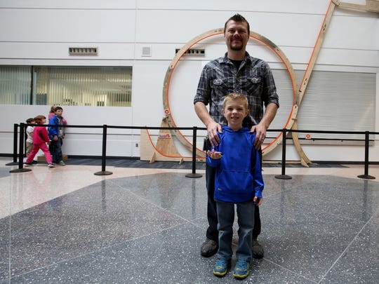 Matt West and his son Blade West, 6, at the Ford Research and Innovation Center on the Ford Motor Company campus in Dearborn on Thursday. West and his son went for a world record with Hot Wheels tracks put together. The previous record was held by a elementary school in Ohio with part of the track diameter at 9.5 feet. The West track had a diameter of 12.5 feet.