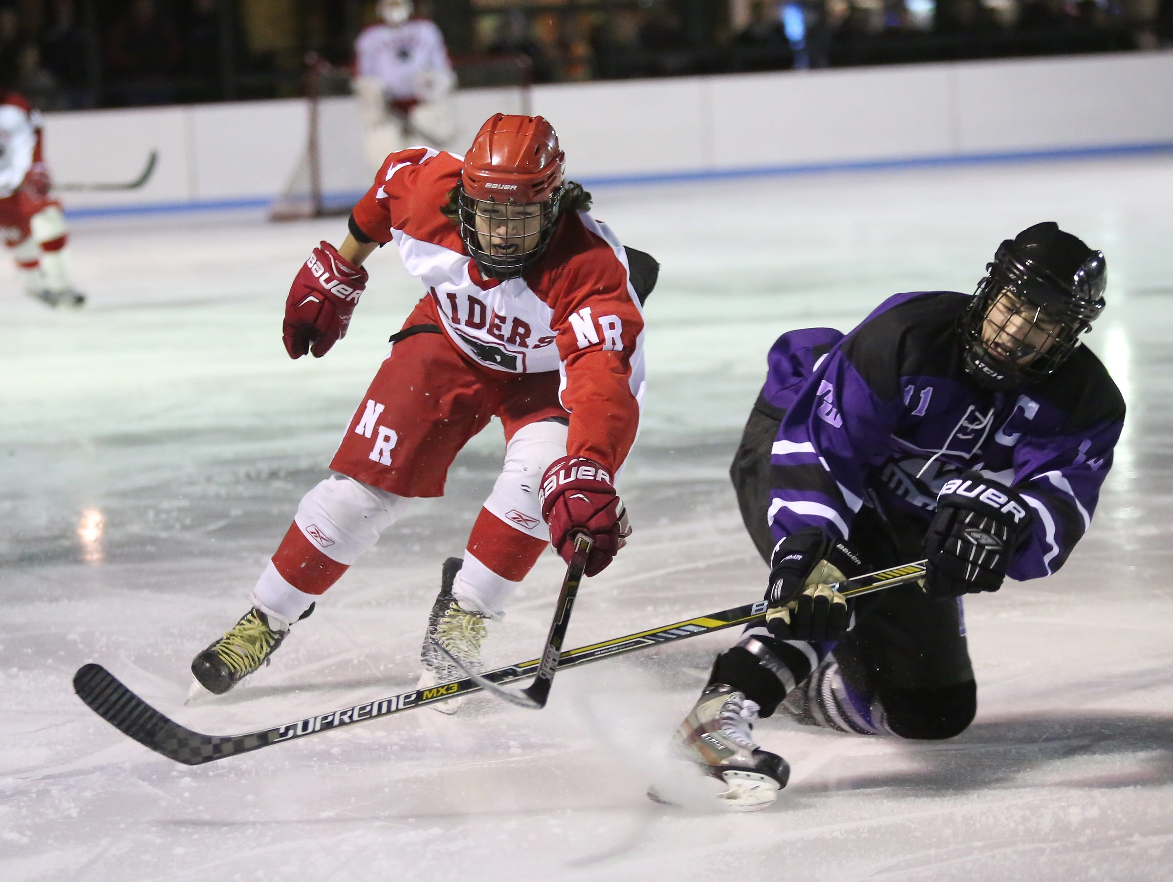 North Roclkland's Jack Guerra (71) reaches for a puck as Monroe-Woodbury defenseman Matt Martin (11) defends during the first annual Winter Classic Hockey Tournament at the Bear Mountain Ice Rink in Tompkins Cove on Friday, Dec. 18, 2015.