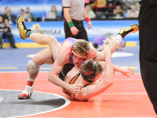 Penfield's Cooper Kropman, top, wrestles in the 152-pound quarterfinal match of the NYSPHSAA Wrestling Championships at Times Union Center in Albany on Friday, February 23, 2018.
