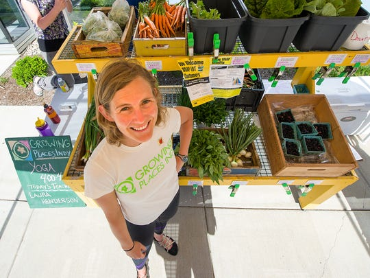 Executive Director of Growing Places Indy, Laura Henderson, poses at the group's vegetable stand.