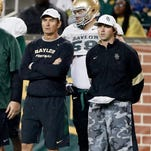 In this March 20, 2015, file photo, then-Baylor coach Art Briles, left, and offensive coordinator Kendal Briles, right, watch a play during the team's NCAA college football intrasquad scrimmage in Waco, Texas. Baylor has kept intact its assistant coaching staff after firing coach Art Briles despite an investigation's multiple findings that football coaches had inappropriate conduct and influence in school assault investigations.