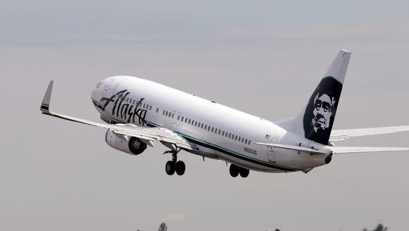 An Alaska Airline jet takes off from Seattle-Tacoma