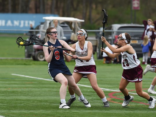 Wappingers' Kate West, left, looks for an open teammate