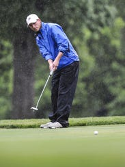 Morristown junior Will O'Neill watches his putt during