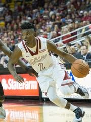 New Mexico State's Braxton Huggins and the Aggies face