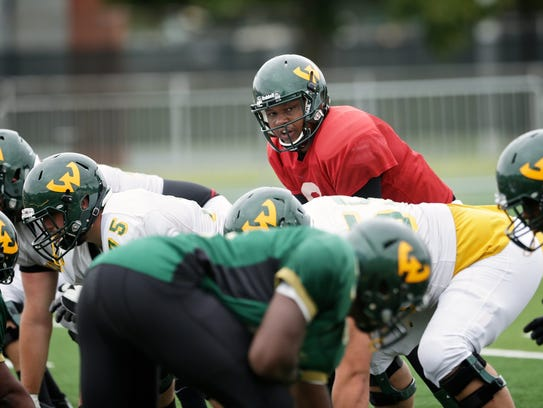Wayne State quarterback Carl Roscoe, 22, of Detroit,