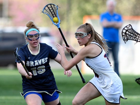 Saddle River Day's Alexa Tsahalis, right, driving to