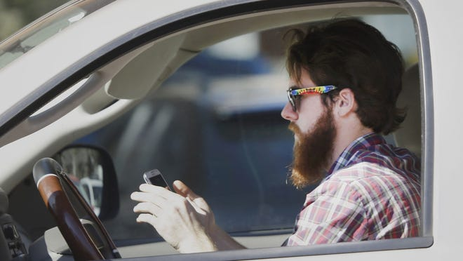 In the five months since a hands-free law took effect in Massachusetts, state troopers have pulled over hundreds of drivers but safety advocates are not sure the message is getting across.