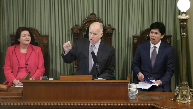 California Gov. Jerry Brown presents his annual State of the State address to a joint session of the Legislature, Thursday, Jan. 21, 2016, in Sacramento, Calif.  Seated are Assembly Speaker Toni Atkins, D-San Diego, left, and Senate President Pro Tem Kevin de Leon, D-Los Angeles.