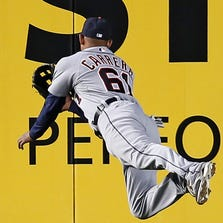 Detroit Tigers center fielder Ezequiel Carrera makes a diving catch of Jacoby Ellsbury's third inning fly ball in a baseball game against the New York Yankees at Yankee Stadium in New York, Monday, Aug. 4, 2014.
