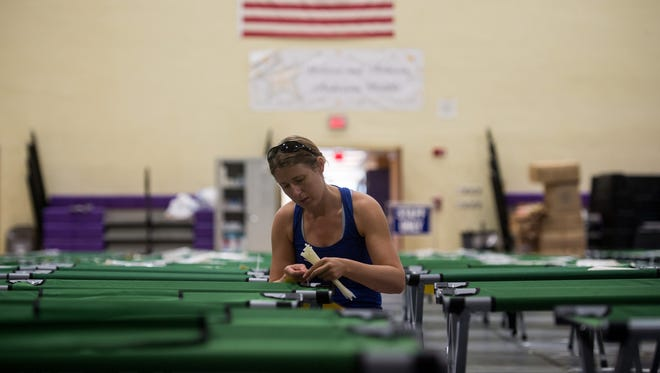 Shelter manager Jennifer Furtwangler, of Palm City, prepares Friday, Sept. 8, 2017, at the special needs shelter at Anderson Middle School in Martin County. The School District of Martin County is still compiling the cost of Hurricane Irma to the district, with most costs coming from preparation, opening and operation of shelters.