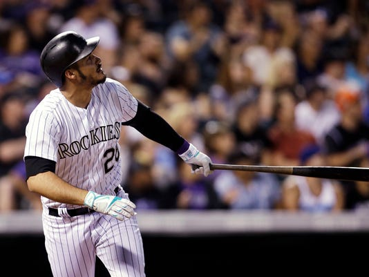 Colorado Rockies' Nolan Arenado watches his two-run home run against the Chicago White Sox during the sixth inning of a baseball game Friday, July 7, 2017, in Denver. (AP Photo/Joe Mahoney)