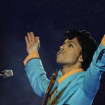 Prince performs during the halftime show at Super Bowl XLI at Dolphin Stadium in Miami in 2007.