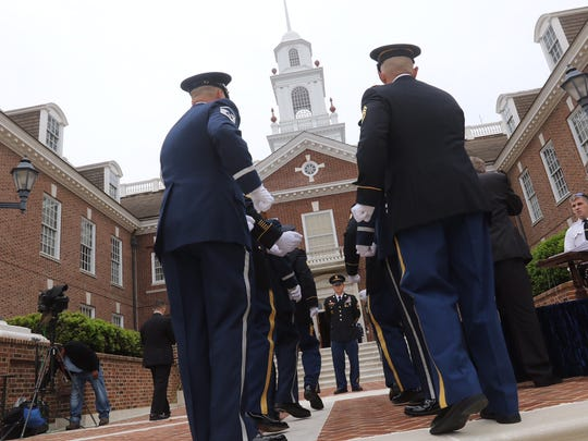 Honor guard practices bringing the casket in for Beau Biden memorial service in Dover Thursday.