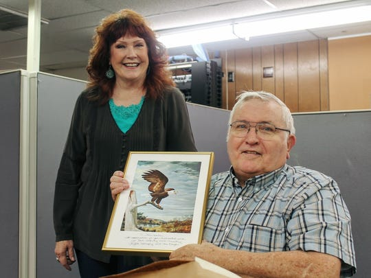 New Mexico President of the Eagle Forum Marcia Stirman presents an award to Eagle Forum member John Gordon signed by the late Phyllis Schlafly Friday, Oct. 14 at the Daily News office. Schlafly passed away on Sept. 5, 2016.