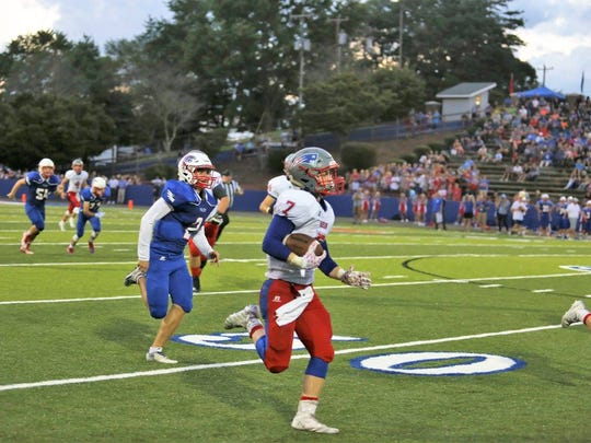 Junior Elan Littrell breaks down the sideline and outruns the West Henderson defense on his way to an 80 yard-TD run.