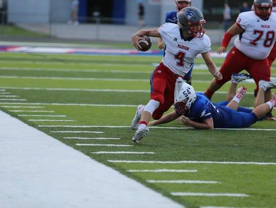 Quarterback Clark Gray gets around the corner for a