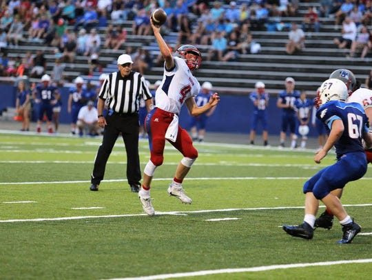 Clark Gray lets fly. The junior quarterback threw for