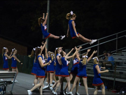 The Madison cheerleaders work an elaborate routine