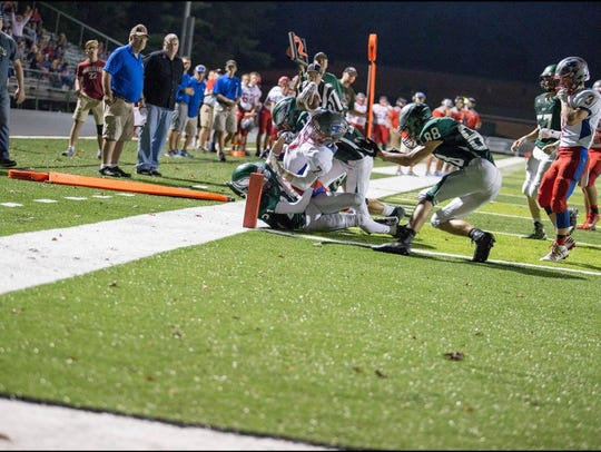 Junior Elan Littrell reaches for the goal line in the