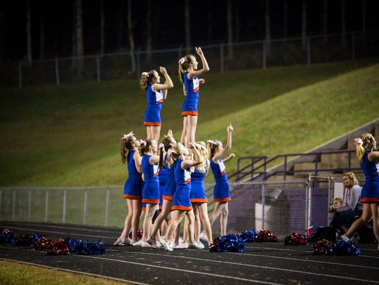 The Patriot cheerleaders perform a routine during Madison's