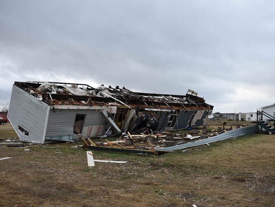 A mobile home is seen destroyed after a tornado struck