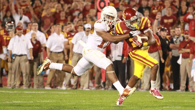 Texas Longhorns linebacker Tevin Jackson (11) tackles Iowa State Cyclones running back Aaron Wimberly (2) during the fourth quarter at Jack Trice Stadium in 2013.