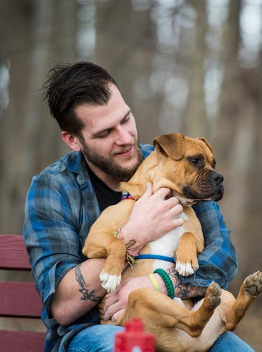 Clay Fredley, a former specialist in the Army and Iraq War combat veteran, sits on a bench with Winston at the Humane Society of Lebanon County on Wednesday, Feb. 2, 2017