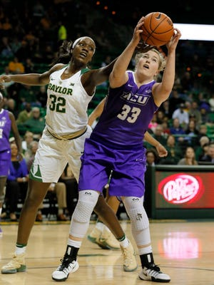 Abilene Christian forward Sydney Shelstead (33) grabs an offensive rebound in front of Baylor's Beatrice Mompremier (32) in the first half Thursday, Dec. 1, 2016, in Waco.