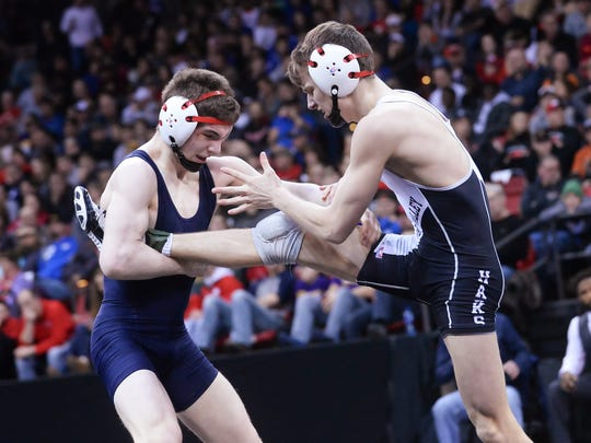 St. John's Northwestern Military Academy/Brookfield Academy freshman Aidan Medora (left) works a leg lift for a takedown on River Valley's Dustin Hatfield In the Division 2, 126-pound championship match. Medora fell in the battle, 4-2.