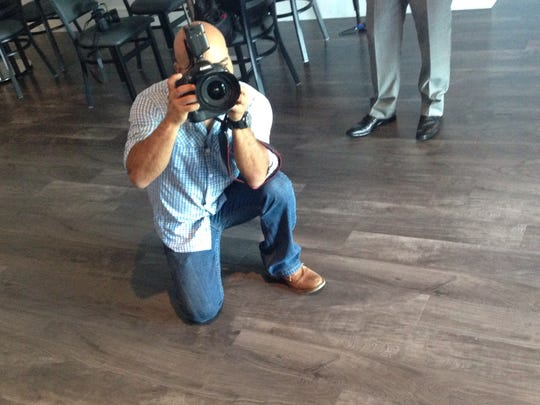 Part of our job: standing still while our photographers check lighting for celebrity chefs.