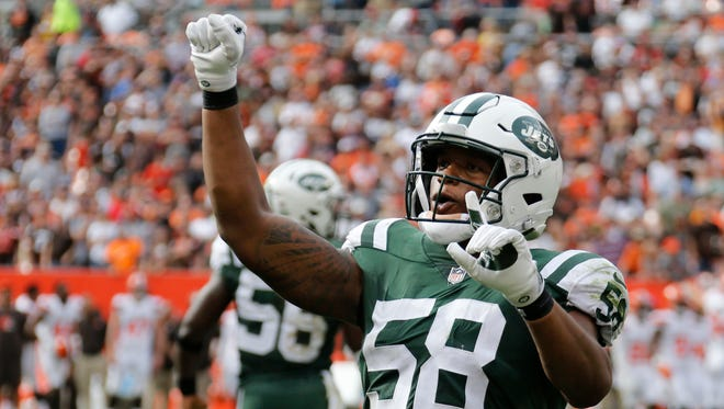 New York Jets inside linebacker Darron Lee celebrates after stopping the Cleveland Browns on 4th and one during the second half of an NFL football game, Sunday, Oct. 8, 2017, in Cleveland.