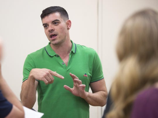 "Director Tralen Doler gives advice to the cast of ""Foolerie"" during rehearsals earlier this month."
