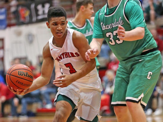 Park Tudor's Isiah Moore, left, is the Panthers' leading