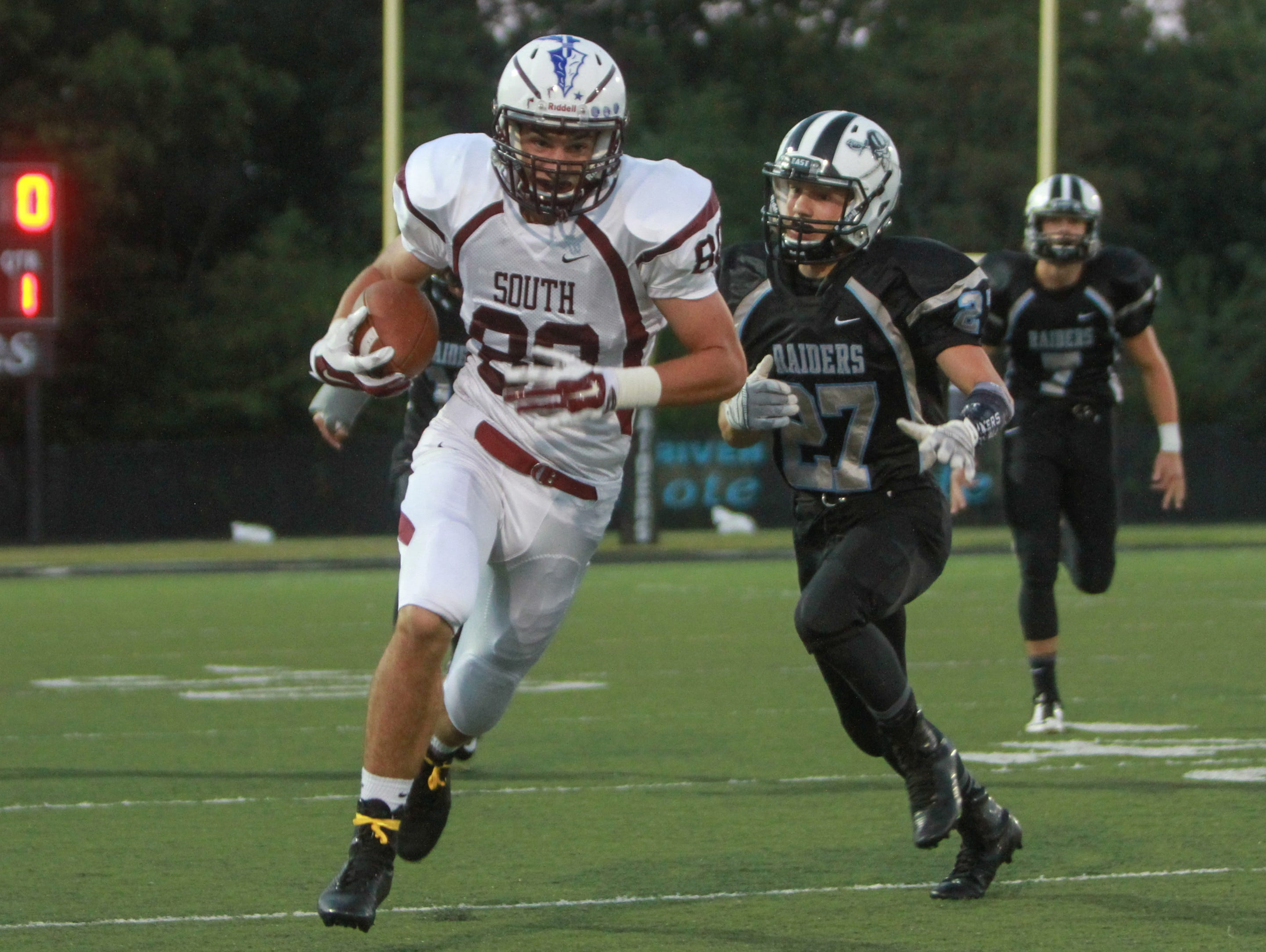 Toms River, NJ TRS #80 Russell Dahlgren vs. TRE #27 Tyler Machnik in the first quarter. Toms River High South at Toms River High School East. 091815 - 3252147