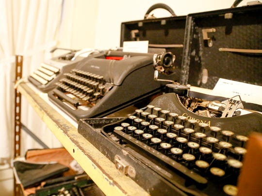 Corona typewriters, progressing from an early model to late model electrics, sit on a shelf at the Groton Historic Society.