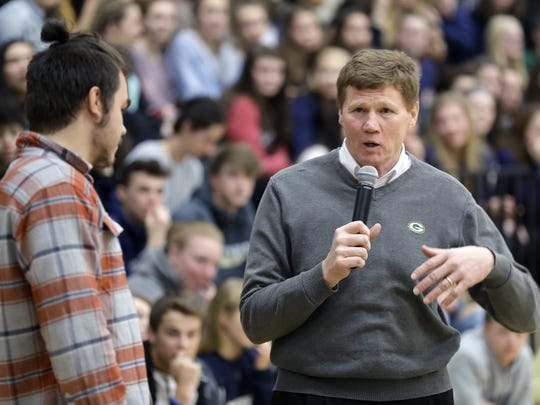President and CEO Mark Murphy answers a question from student Gavin Krause as the Green Bay Packers' annual Tailgate Tour makes a surprise stop at Appleton North High School on Tuesday.