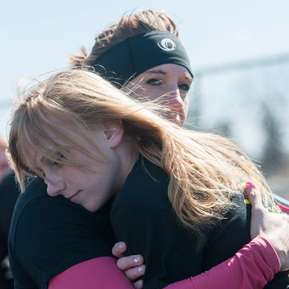 Mandy Spears hugs he daughter Meghan Poleck at the