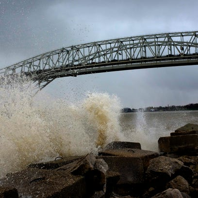 Large waves crash against the seawall at International Flag Plaza in Port Huron. The National Oceanic and Atmospheric Administration reported wave heights reaching seven feet at around noon.